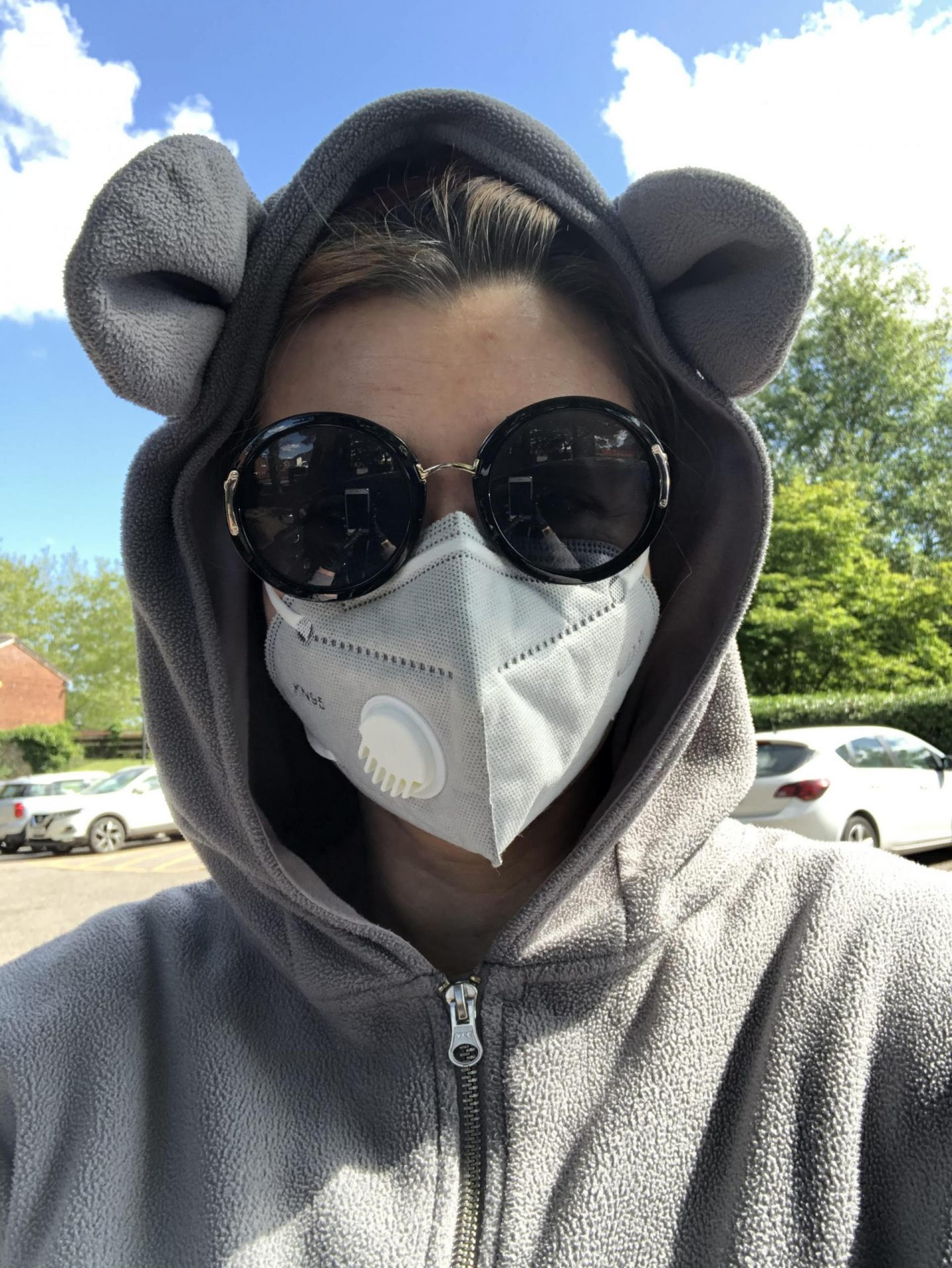 Covid cover up: mask, sunglasses and onesie